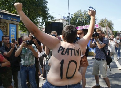 An activist of Ukrainian women movement Femen protests in the Euro 2012 at Fan Zone in Kyiv today.