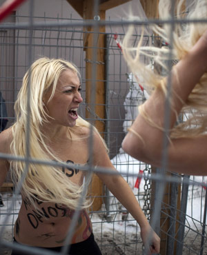 Topless Ukrainian protesters demonstrate from the group Femen, which stages small, half-naked protests against a range of issues including oppression. (Anja Niedringhaus, AP)