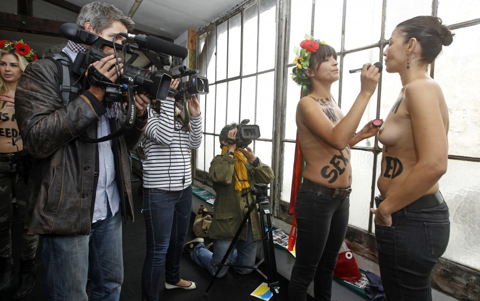 Activists from the topless women's rights group Femen prepare for the inauguration of the 'training camp' in Paris