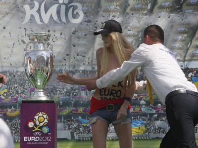 Ukraine feminist strips, attacks Euro 2012 trophy