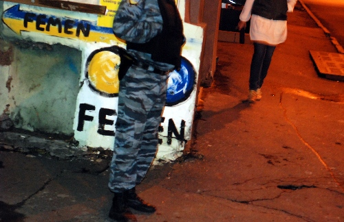 A security officer in Kyiv, Ukraine stands by if needed to arrest FEMEN members