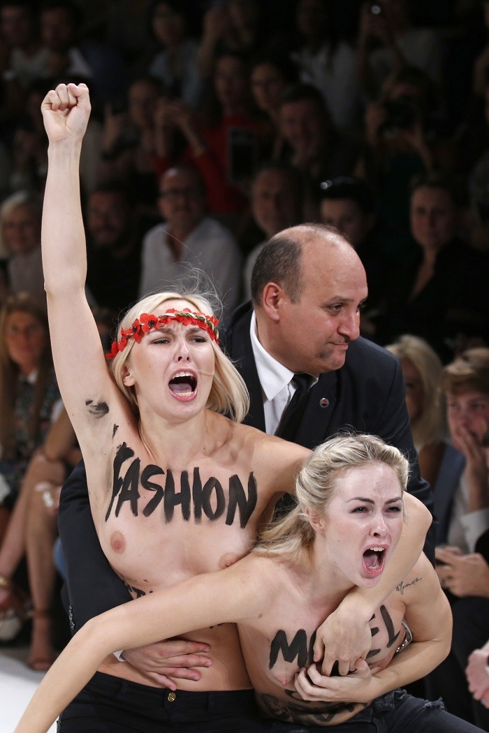 Ukranian feminist protestors FEMEN managed to breach security to reach the fashion week catwalks for the first time.