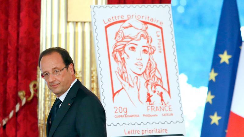 President Hollande onthulde gisteren de nieuwe postzegel tijdens de nationale feestdag