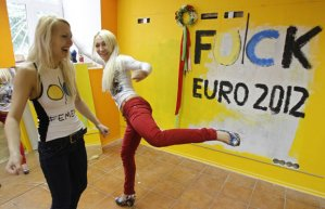 Euro 2012: Topless Ukrainian feminists steal trophy