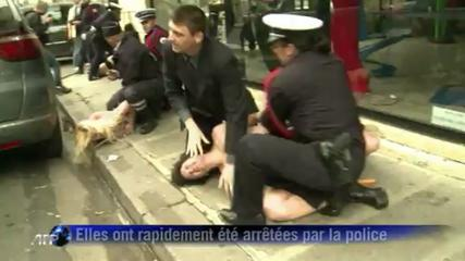 Des Femen manifestent seins nus devant l'Elyse