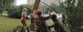 Pussy Riot protest: Topless protester cuts down Cross