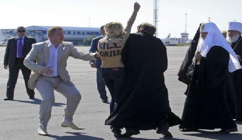 Topless Protestor Attacks Patriarch Kirill In Kyiv