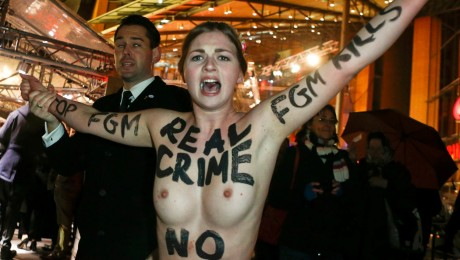 An activist from the women's rights organisation Femen protests before the screening of the movie Yi Dai Zong Shi, The Grandmaster at the 63rd Berlinale International Film Festival in Berlin