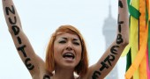 A topless activist of the Ukrainian wome