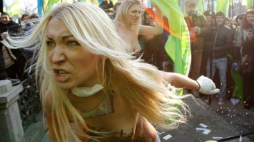 Activists from women's rights group Femen shout slogans during an opposition rally in Kyiv