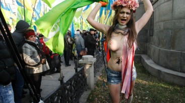An activist from women's rights group Femen shouts slogans during an opposition rally in Kyiv