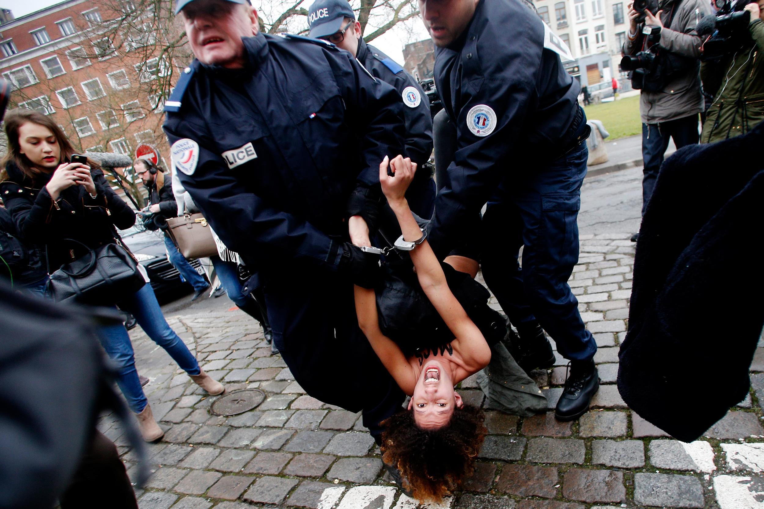 Image:  FEMEN protester is arrested in Lille, France