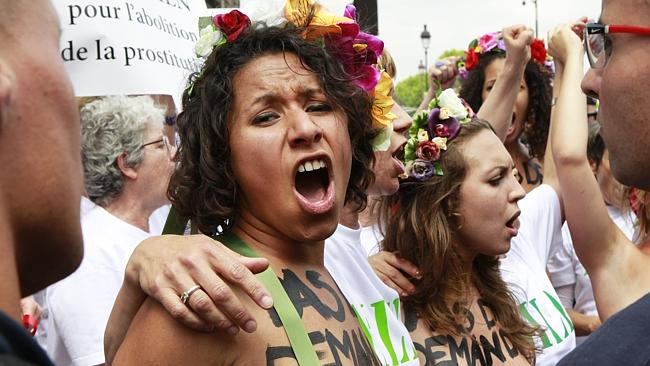 Femen activists call for the abolition of prostitution at the French National Assembly in